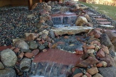 Stone Water Fall with Walk Way in Back Yard