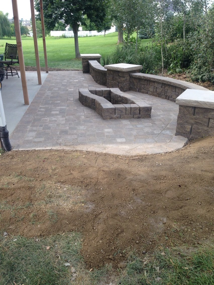 Patio Area with Large Stone and Fire Pit