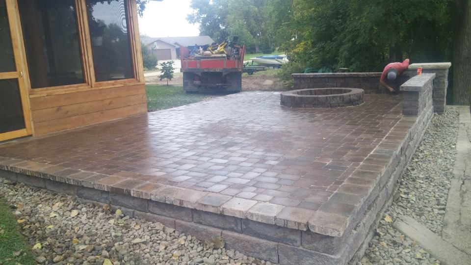 Large Patio in Back Yard with a Fire Pit
