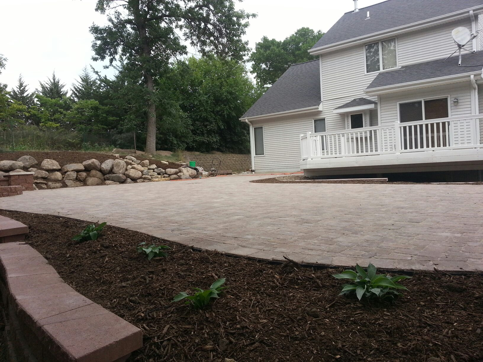 Backyard Patio Area with Manicured Landscaping